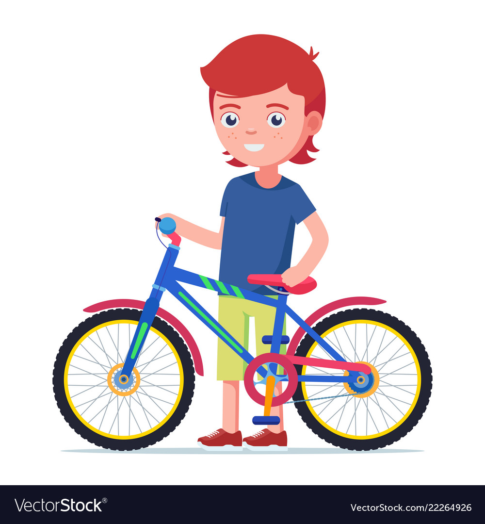 Boy standing next to a colorful children bicycle