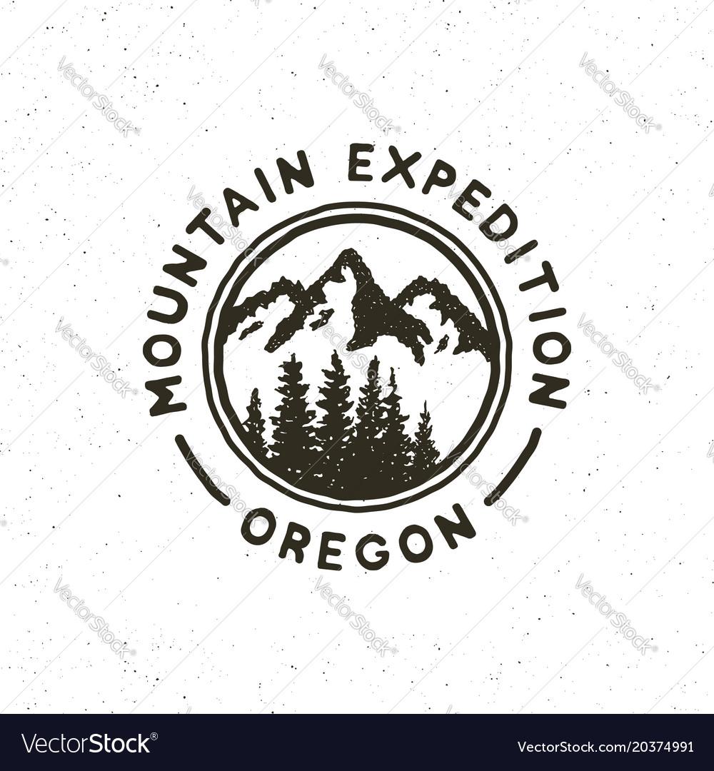 Vintage wilderness logo hand drawn retro styled
