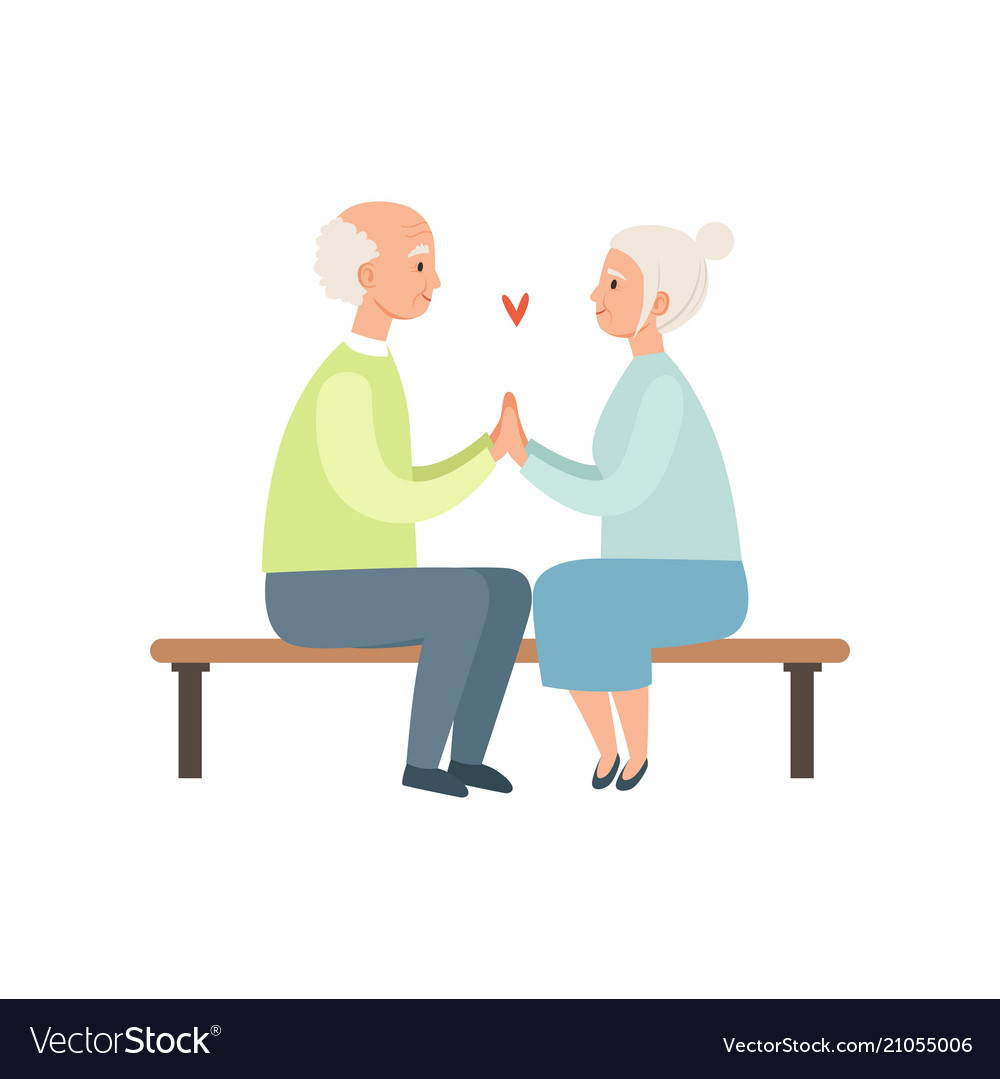 Senior man and woman sitting on a park bench
