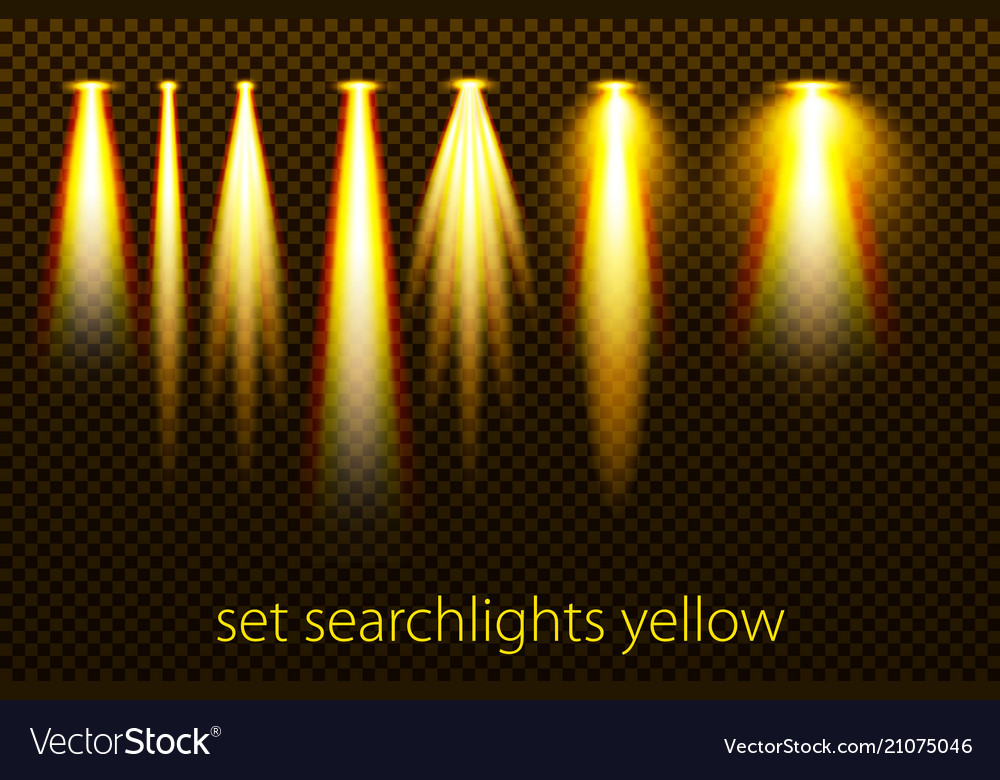 Set of yellow searchlights on a transparent