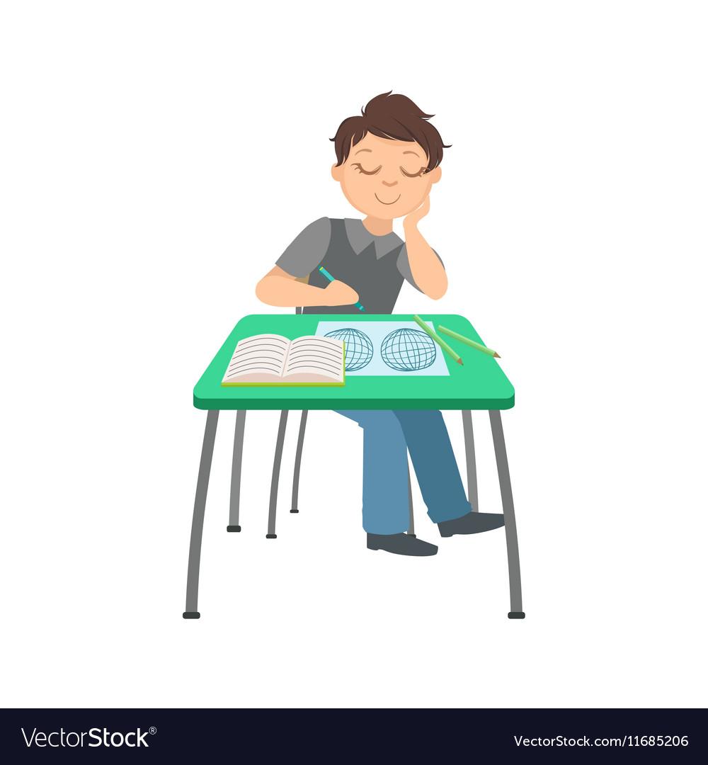 Schoolboy Sitting Behind The Desk In School Class