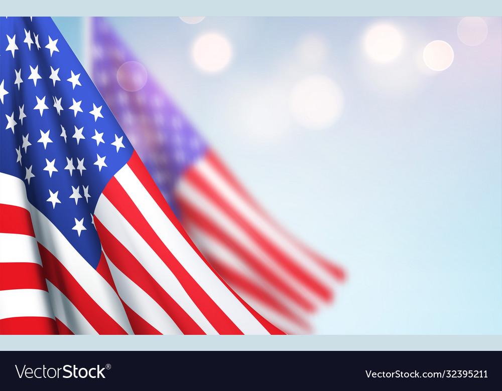 America flag waving against a clear blue sky