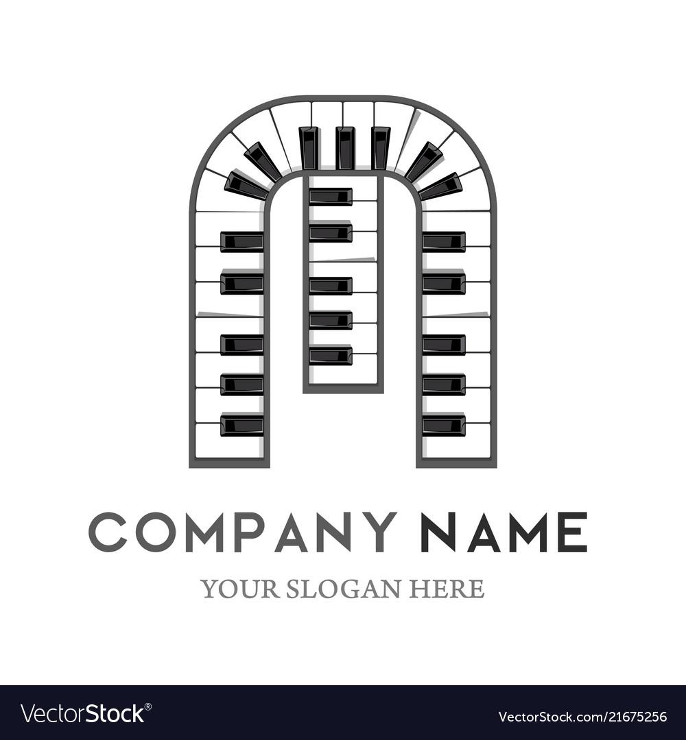 M letter logo design piano keyboard logo