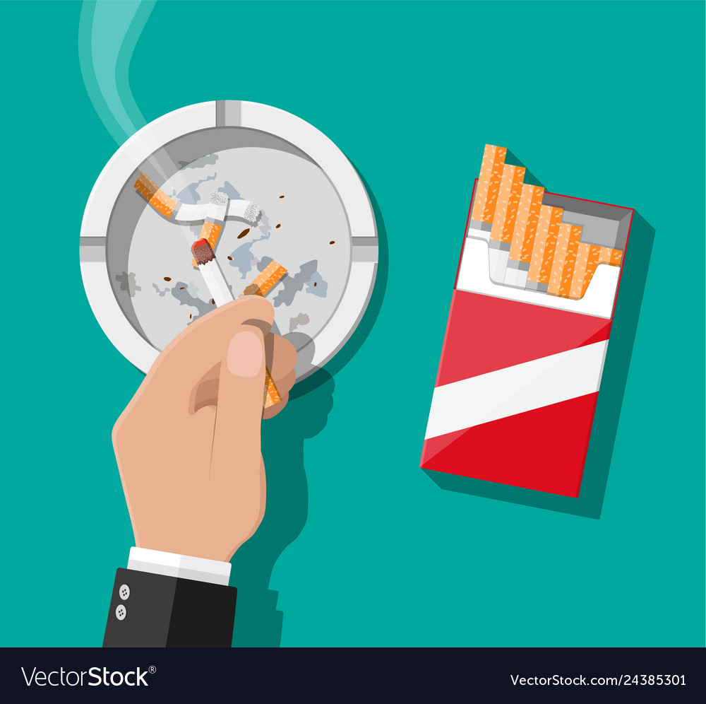White ceramic ashtray full of smokes cigarettes