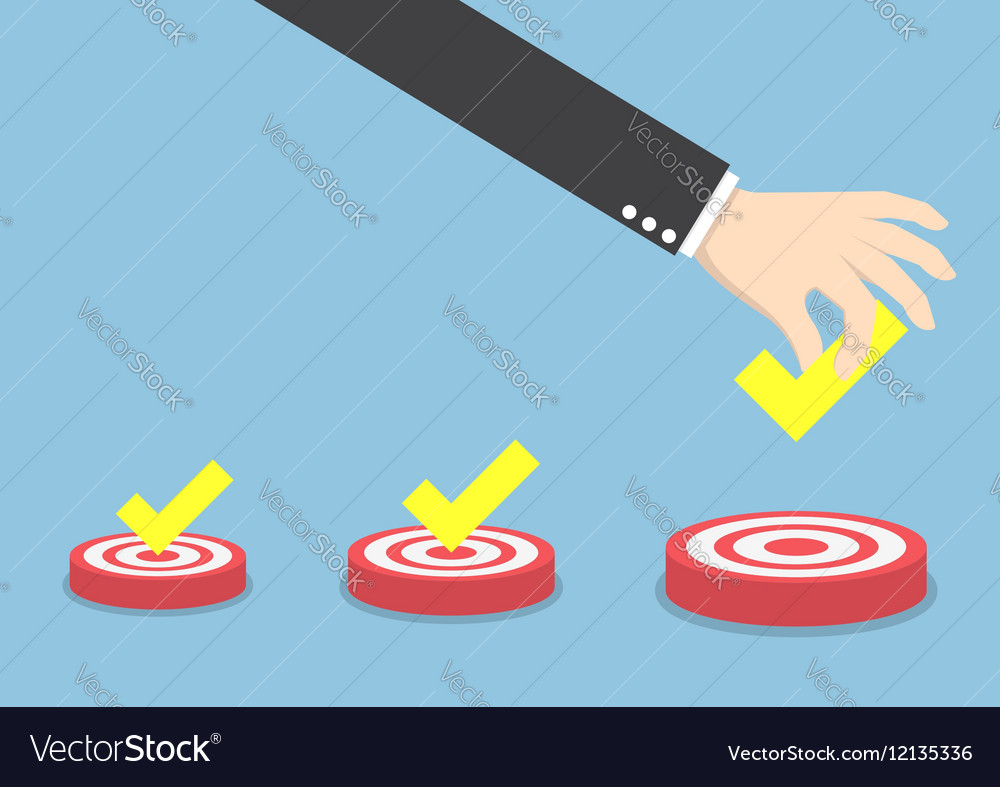 Businessman hand put the check mark on targets