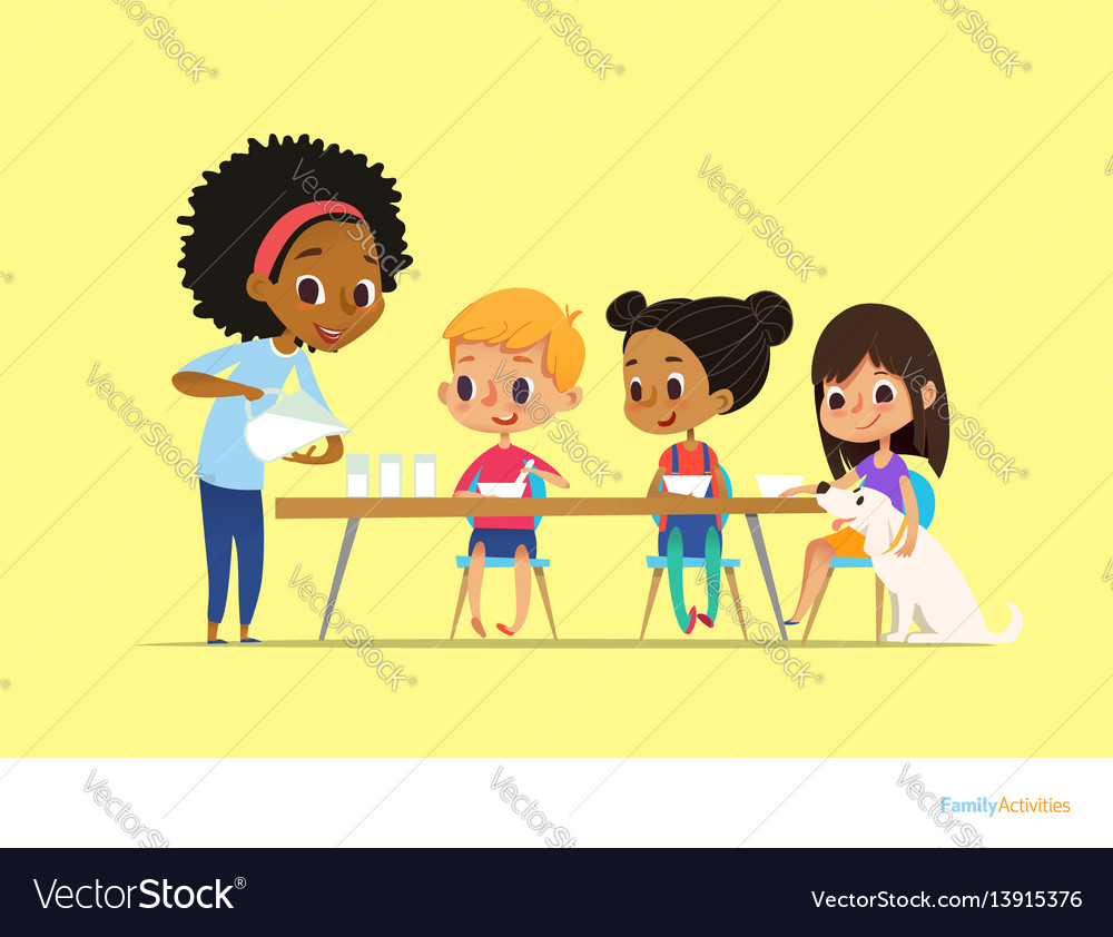 Smiling multiracial children sit at table and have