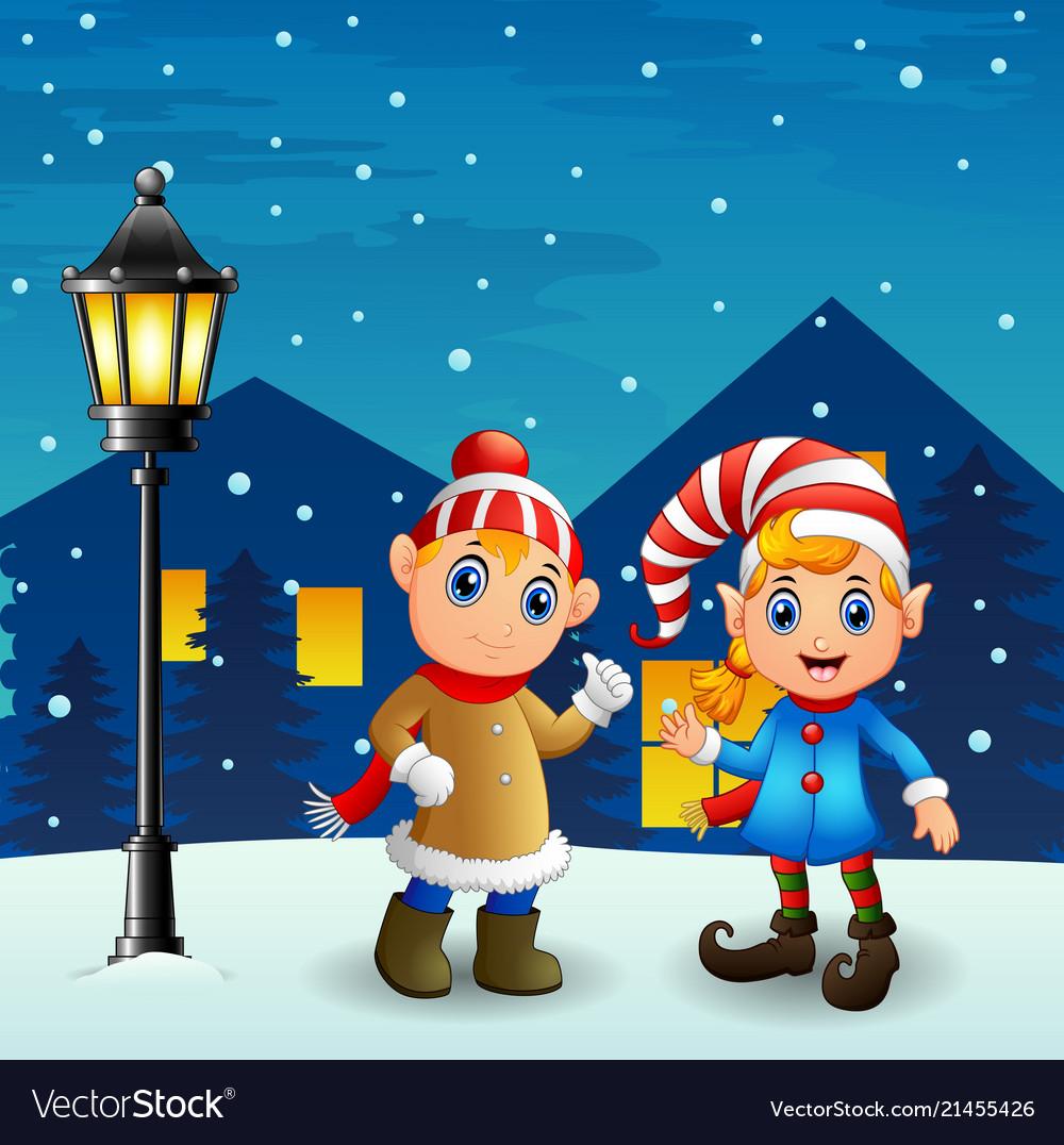 Christmas Elf Couple With Snowfall Falling At Nigh