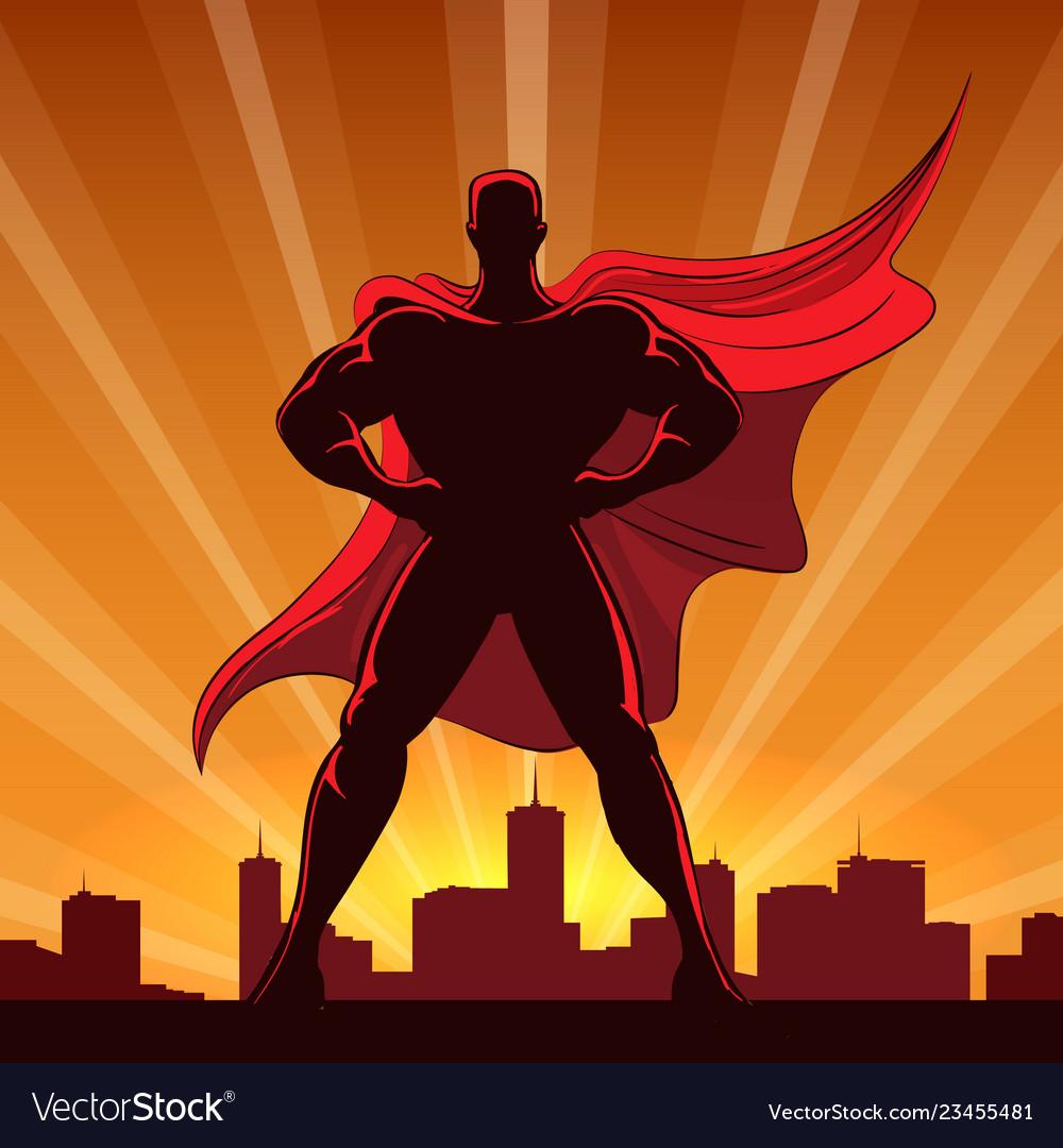 Superhero silhouette in red cape