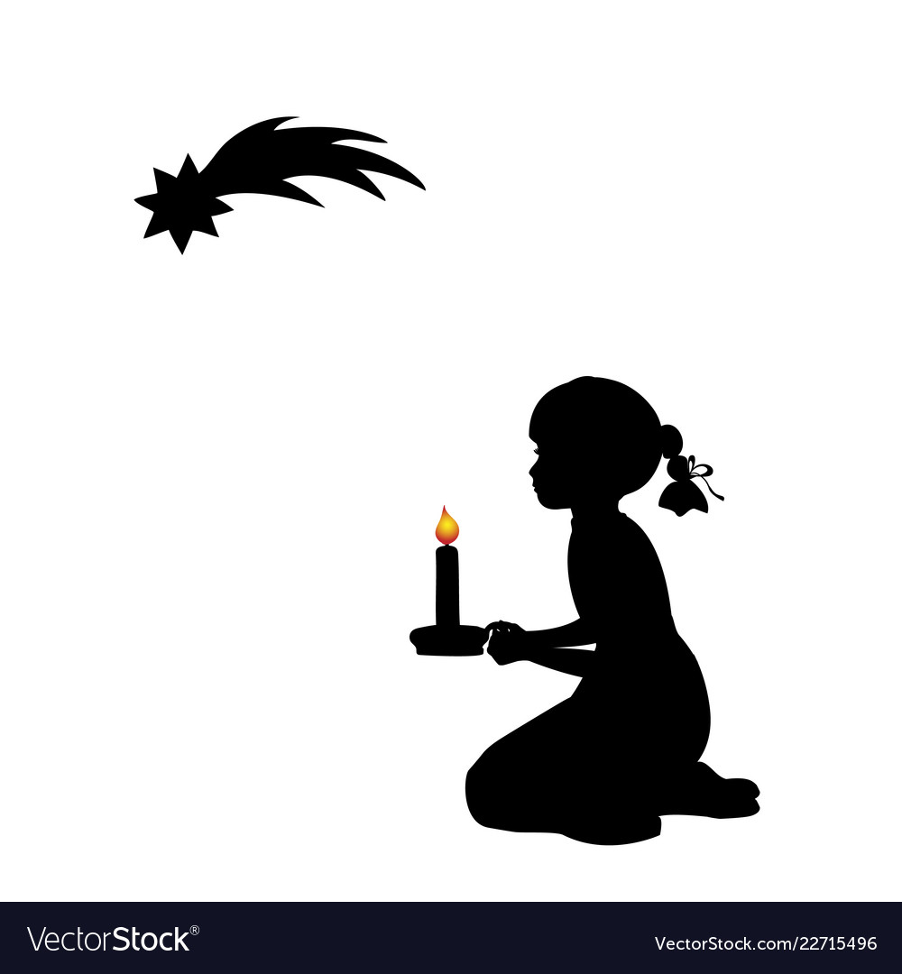 Silhouette praying girl with candle christmas