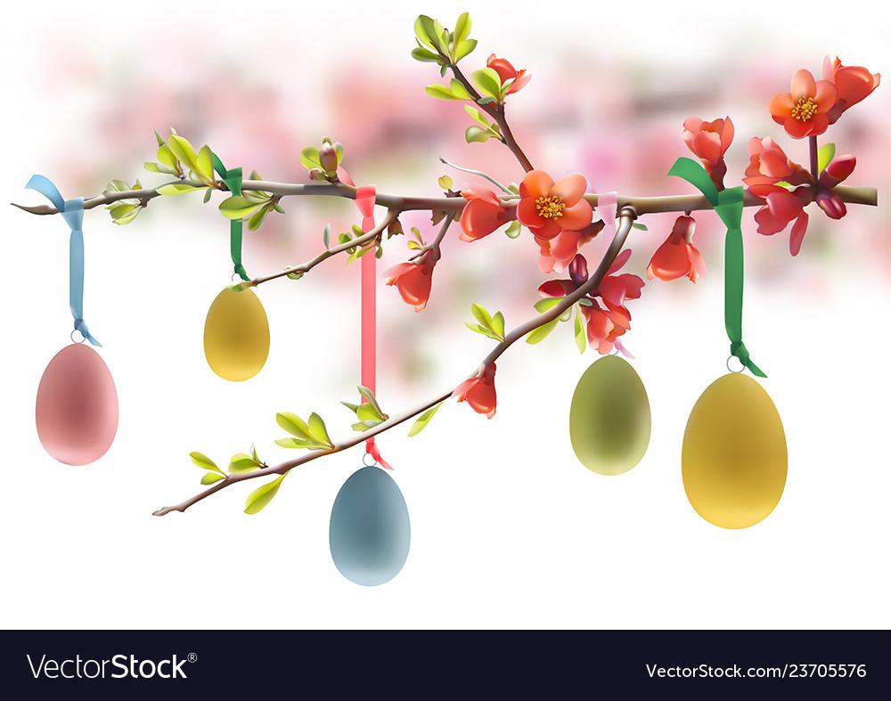 Easter eggs hanging on flowering branch
