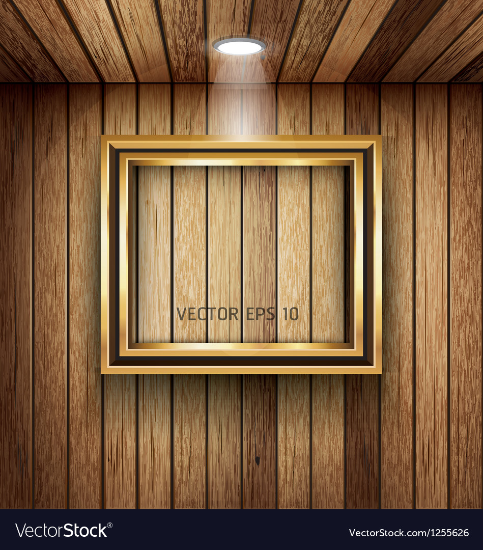 Gold frame on wood wall with spotlight