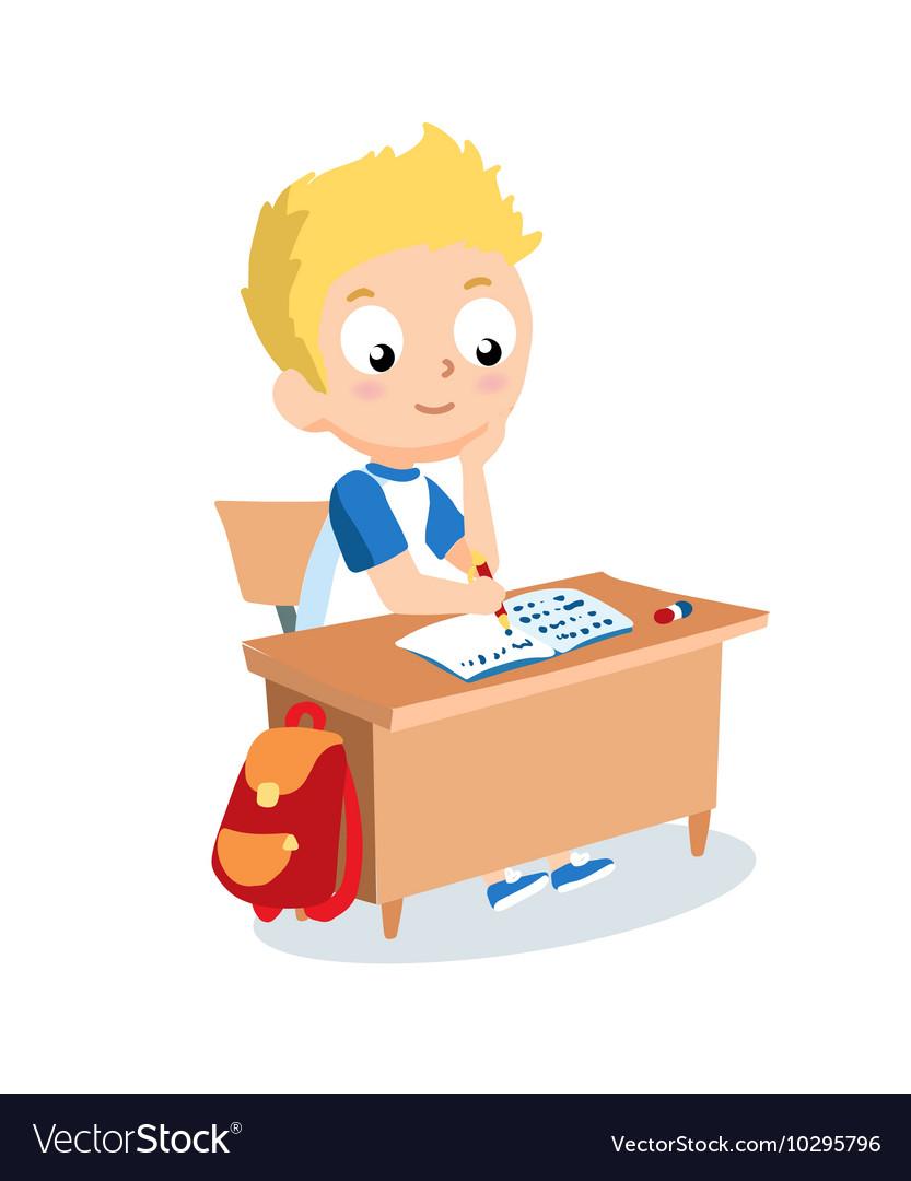 Schoolboy sitting at school desk Pupil