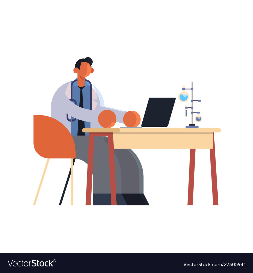 Male doctor using laptop man researcher sitting at