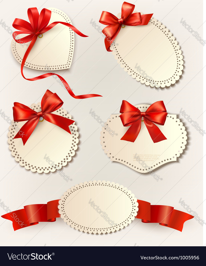 Set of beautiful tags with red gift bows with