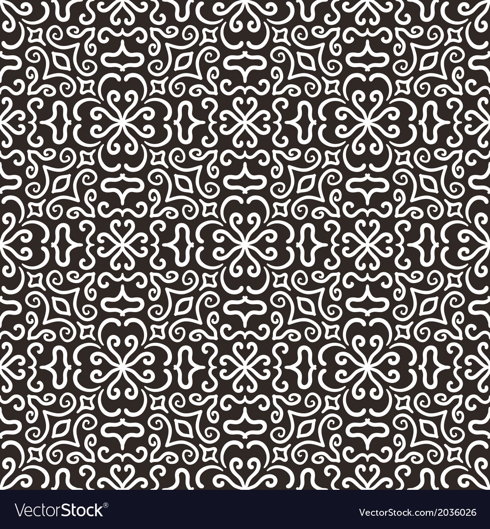 White graphic flower pattern on dark background