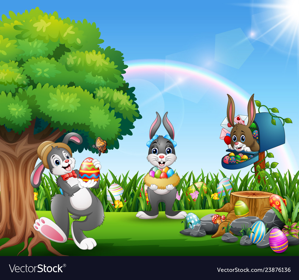 Easter bunnies and colorful egg on the garden