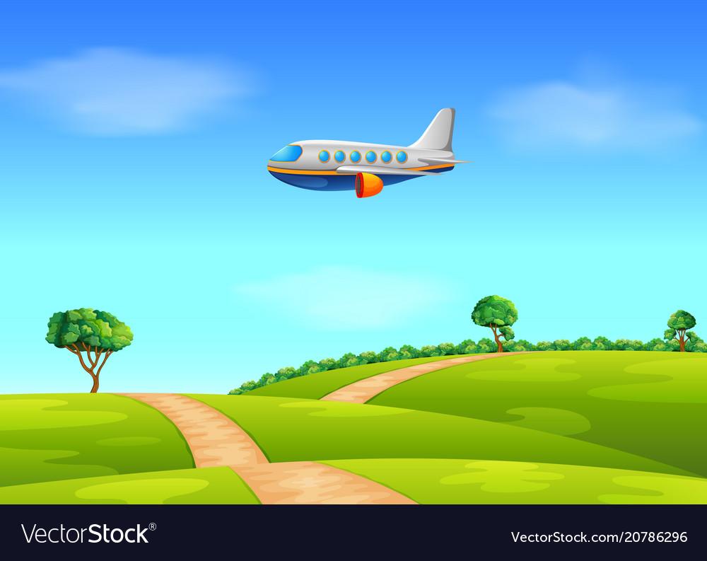 A passenger plane flying over field