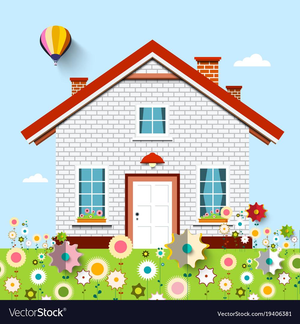 House on garden full of flowers