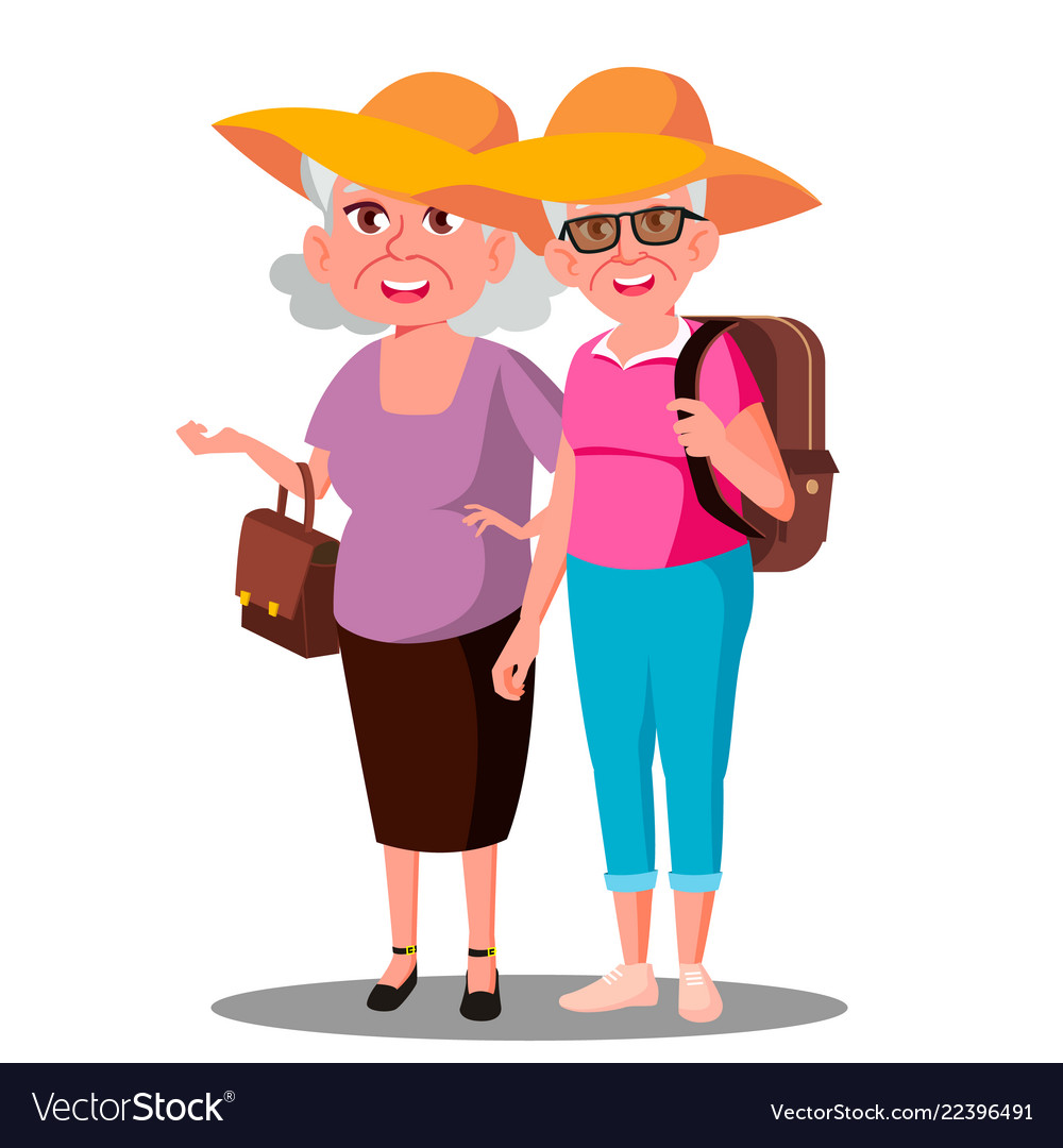 Two old women friends in hats enjoing vacation