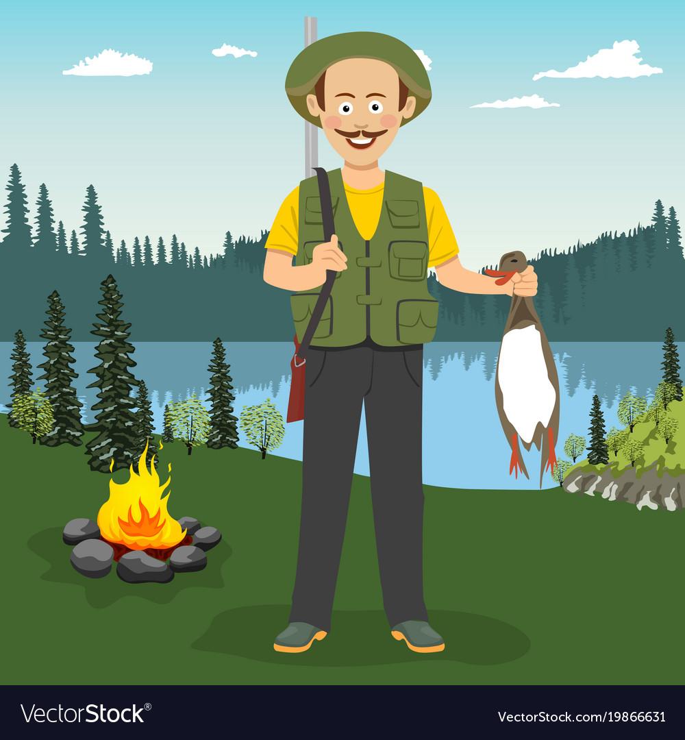Happy hunter holding duck outdoor