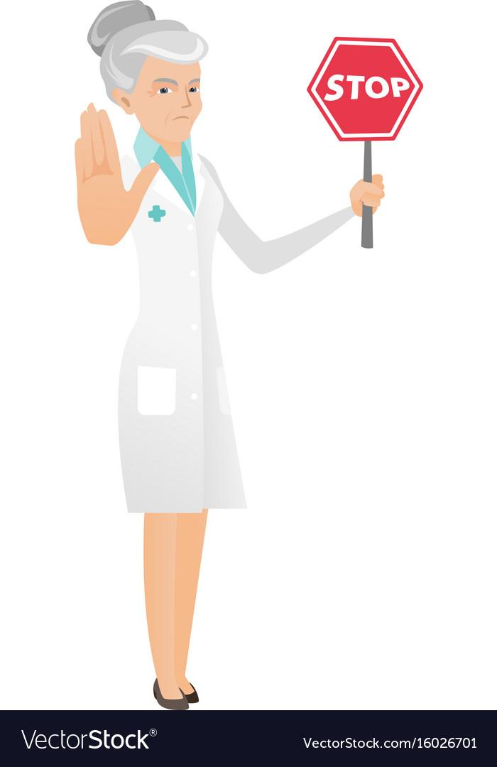 Senior caucasian doctor holding stop road sign