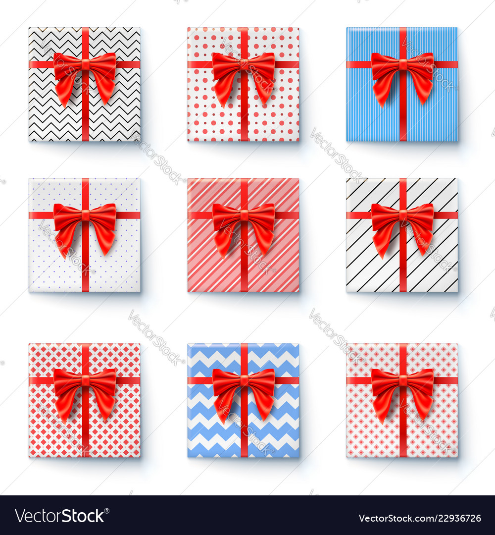 Present boxes with red ribbon and big bow isolated