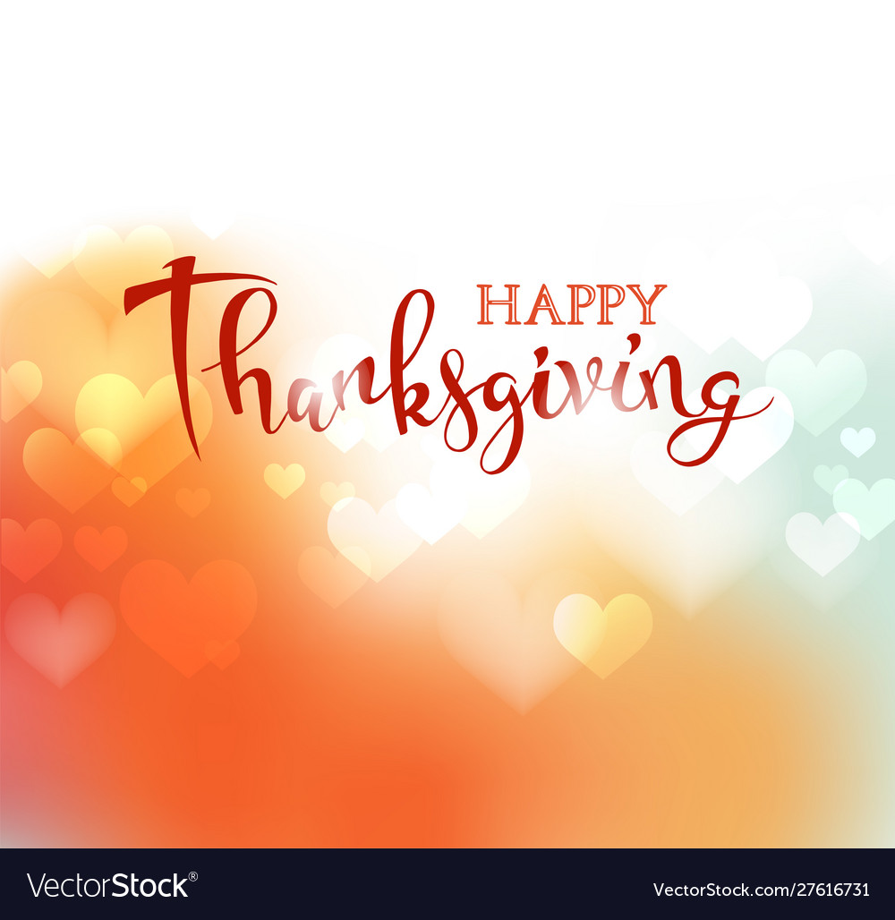 Hand drawn happy thanksgiving lettering on blurred