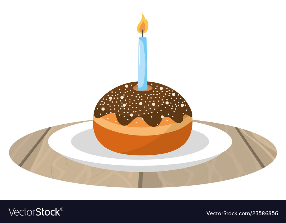 Cake with candle on dish