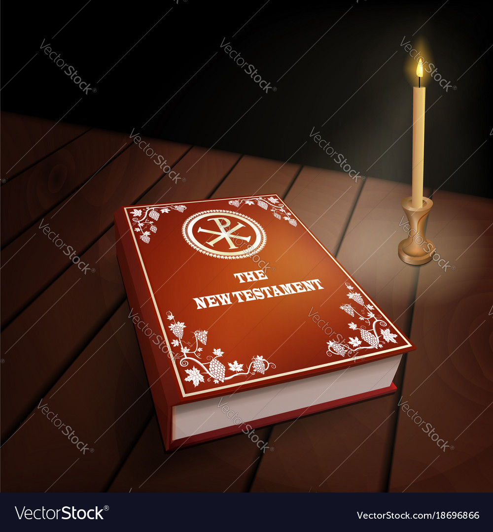 New testament book on wood table with candle
