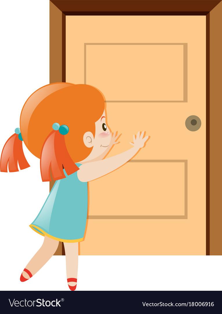 Little girl pushing the door open