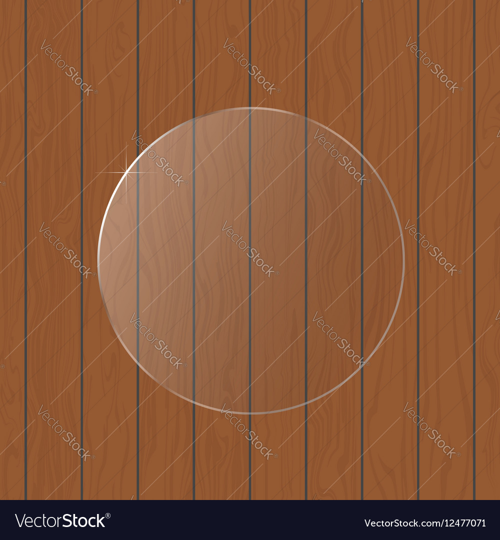 Round glass on a wooden background
