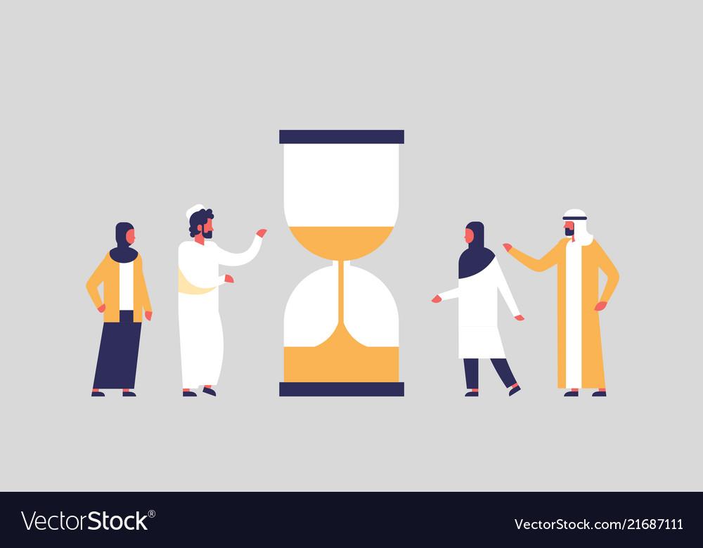 Arabian people group standing hourglass time