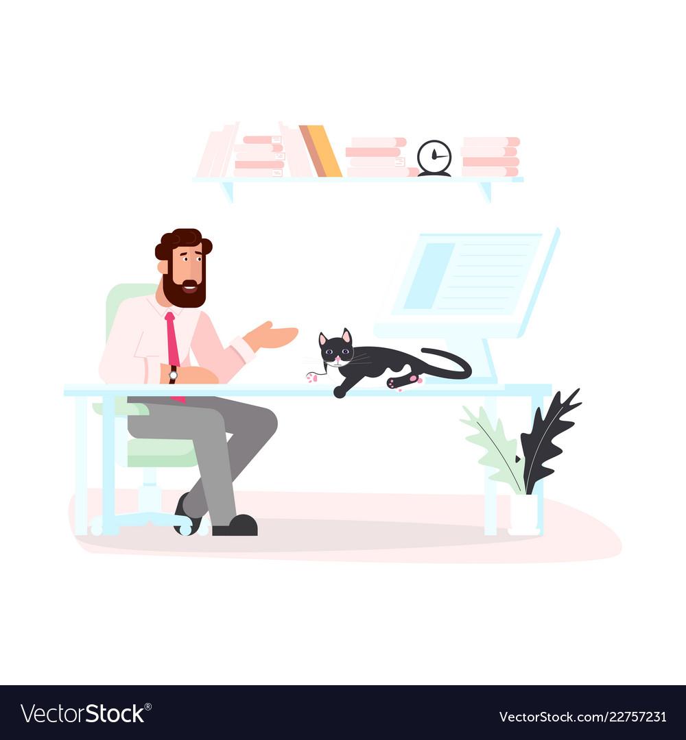 Black cat lies on a computer desk