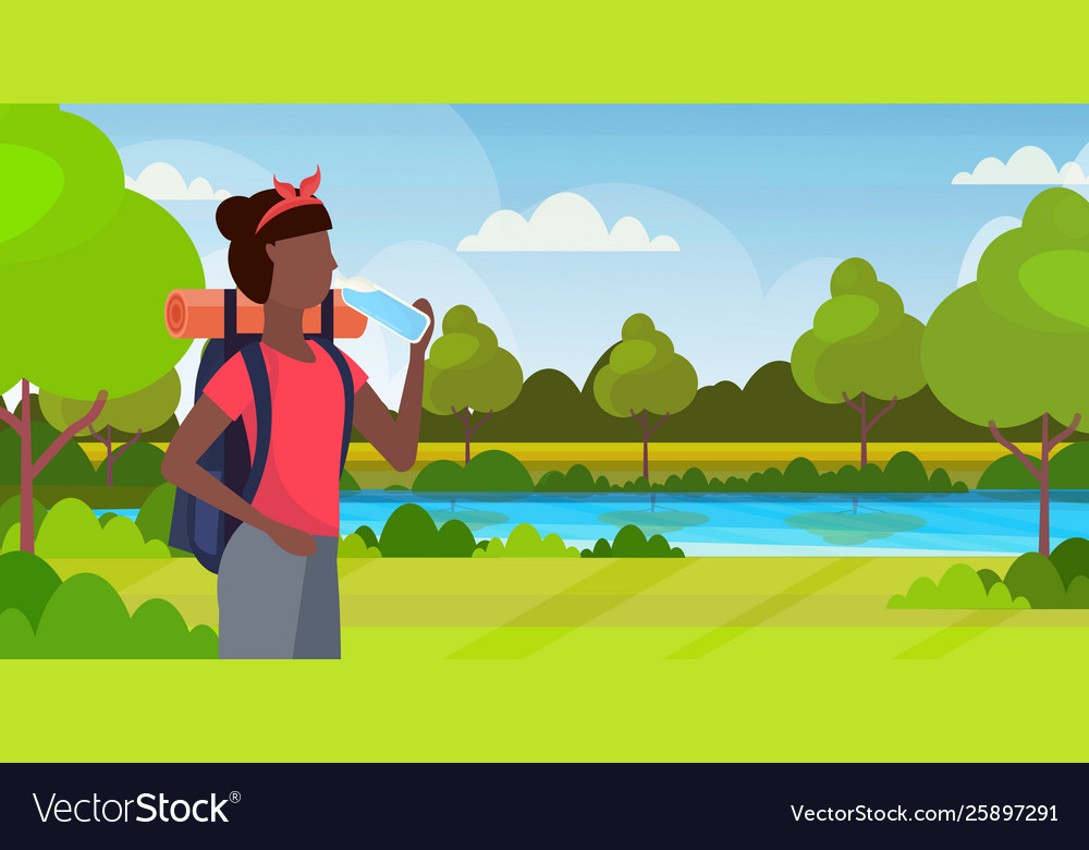 Woman hiker with backpack drinking water african