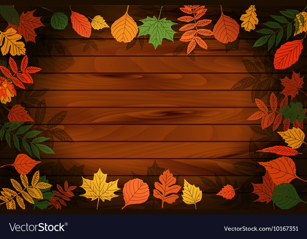 Autumn leaves on the background wood