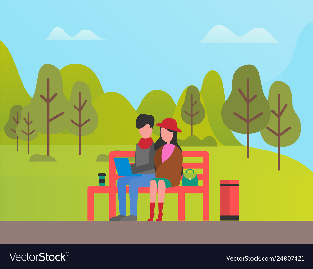 Couple sitting in park man and woman relaxing
