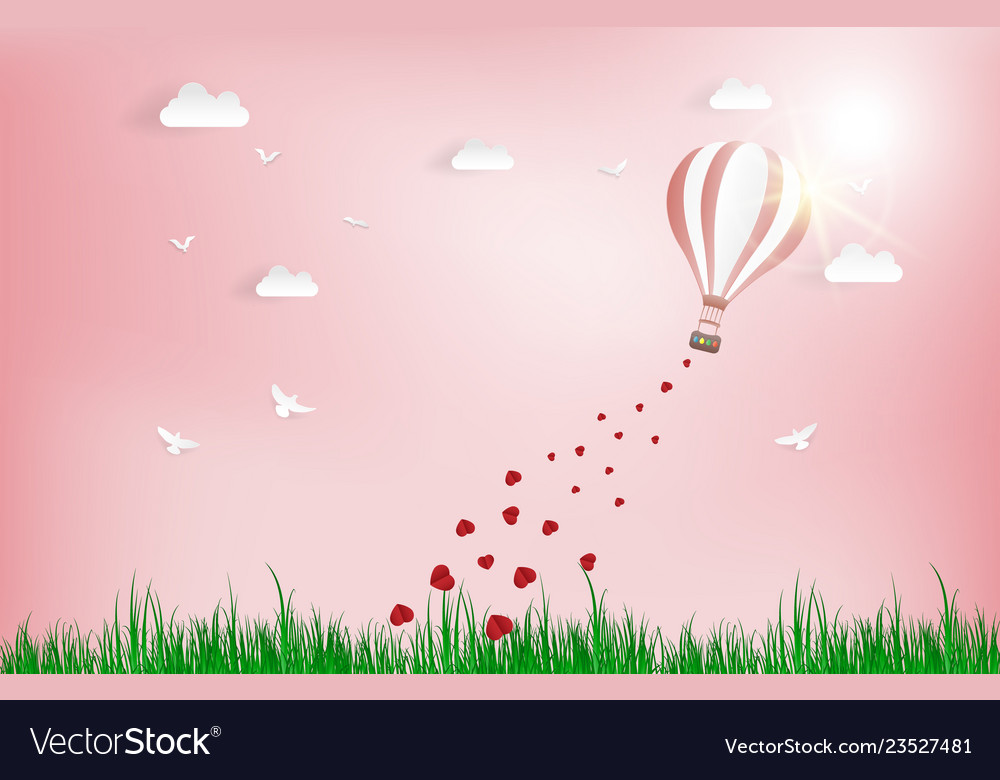 Balloon flying over grass with heart float on the