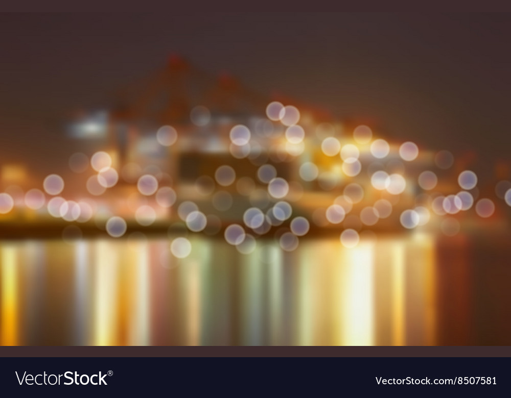 Blurred City Lights by a Harbour