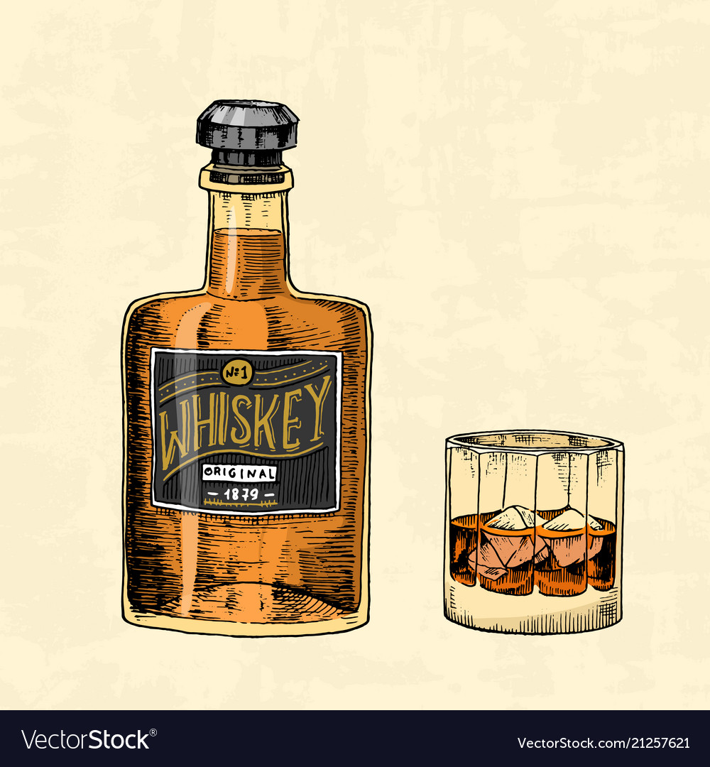 Vintage whiskey bottle with label and a glass