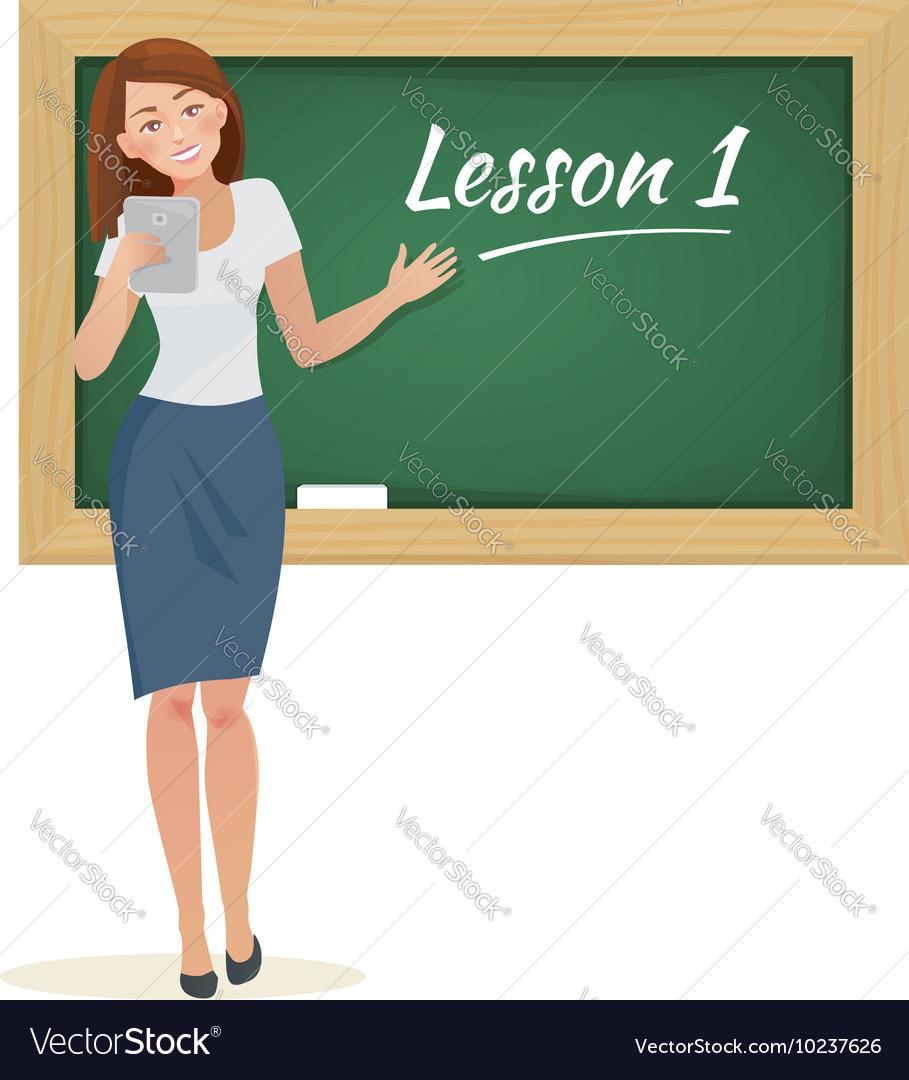 Woman teacher stands at the blackboard