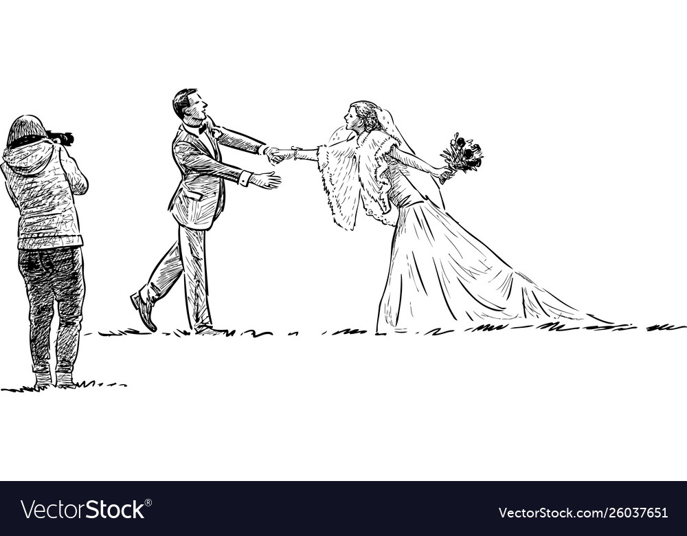 Newlyweds and photographer