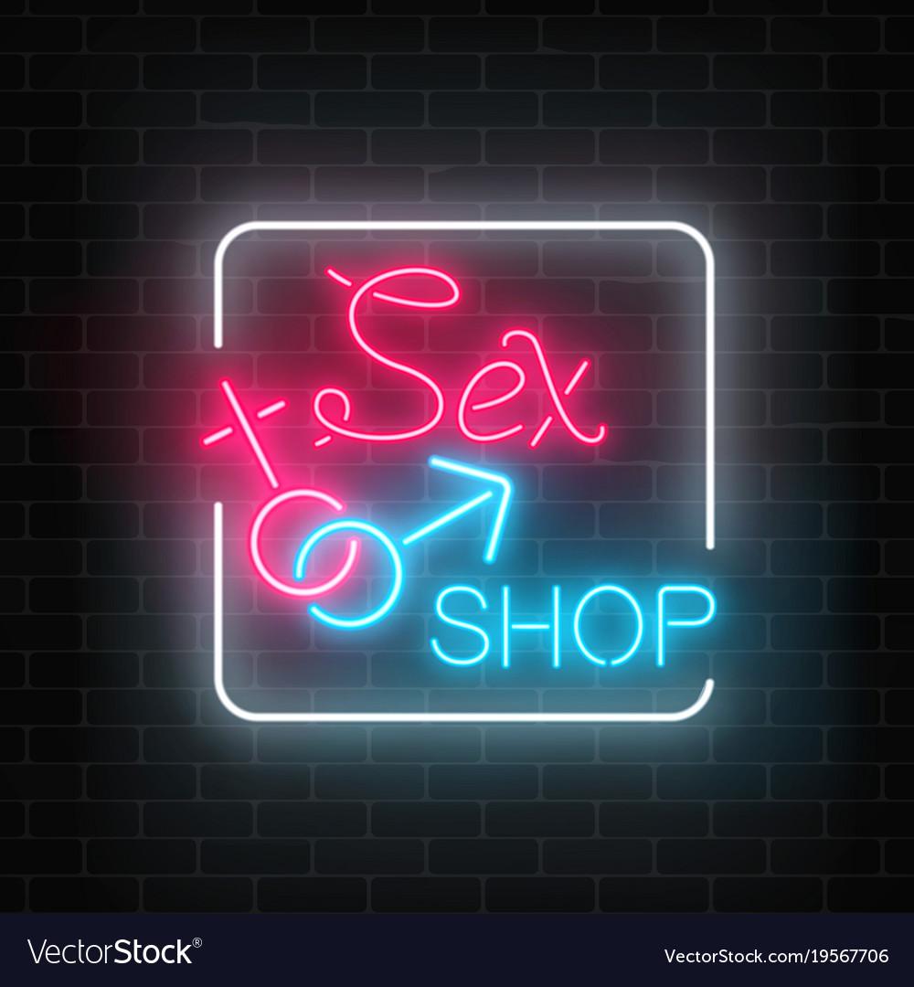 Glowing neon sex shop street sign on dark brick