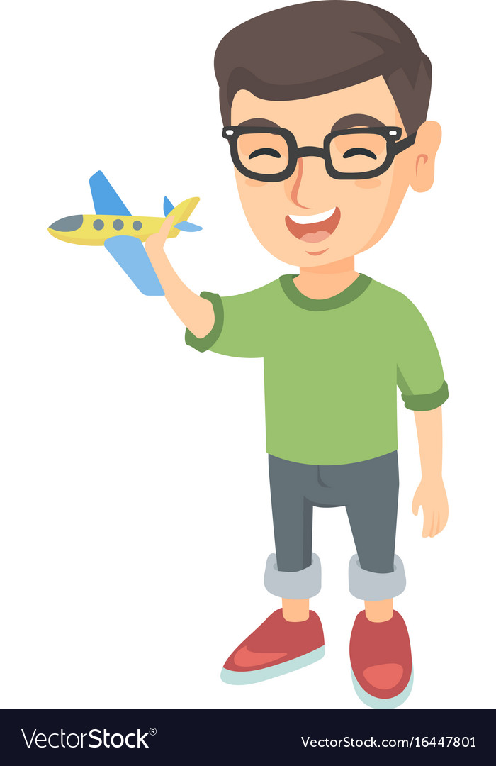 Caucasian Cheerful Boy Playing With A Toy Airplane