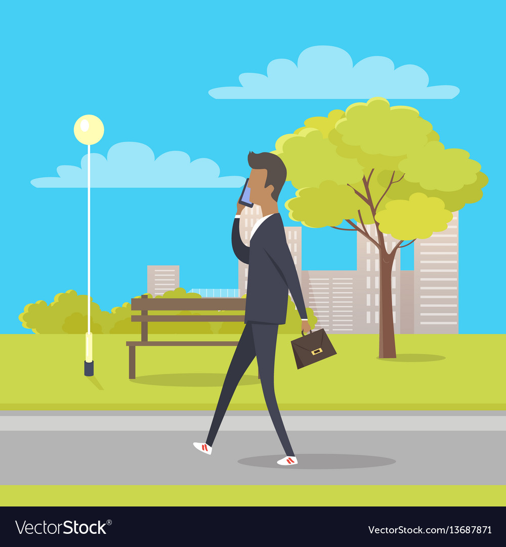 Businessman speaks by phone and walks in park vector image