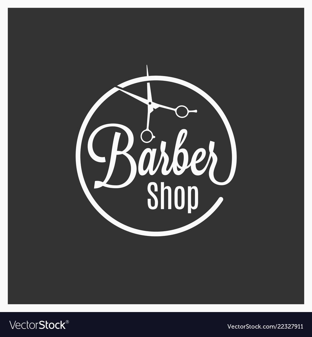 Barbershop vintage logo with barber scissors on