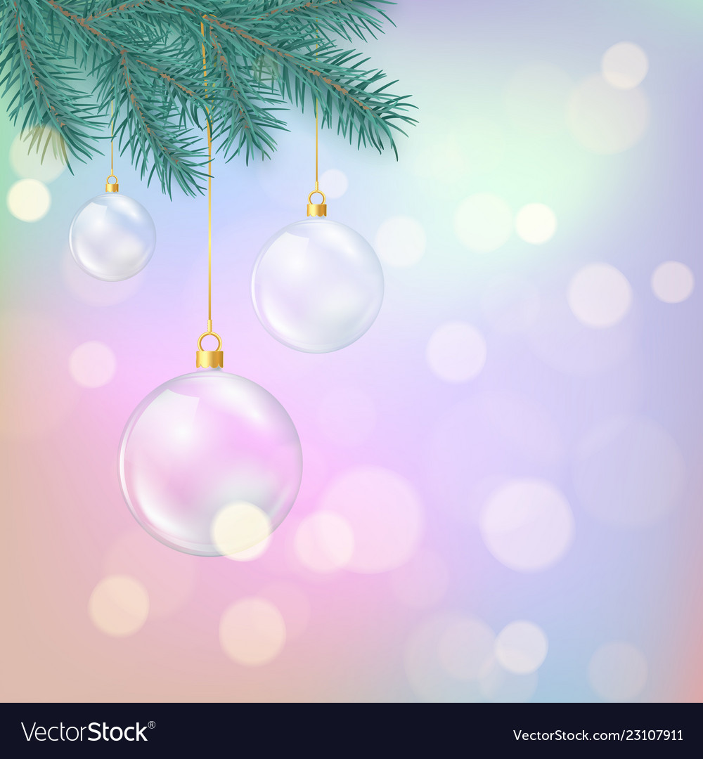 Glass christmas balls hanging on fir branch magic