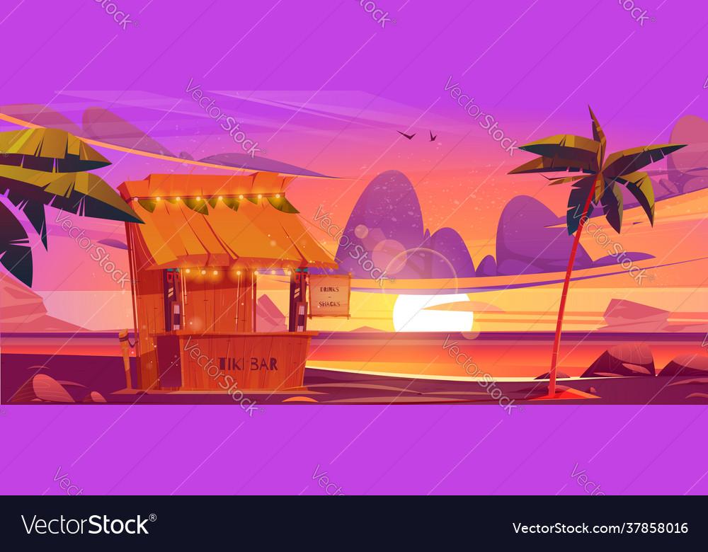 Tiki bar with tribal masks on sea beach at sunset