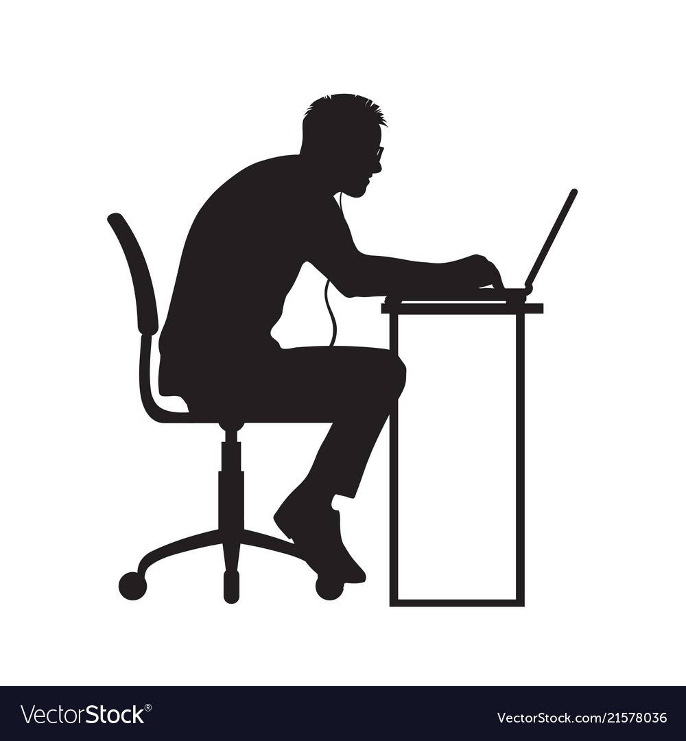 Silhouette of man working at computer