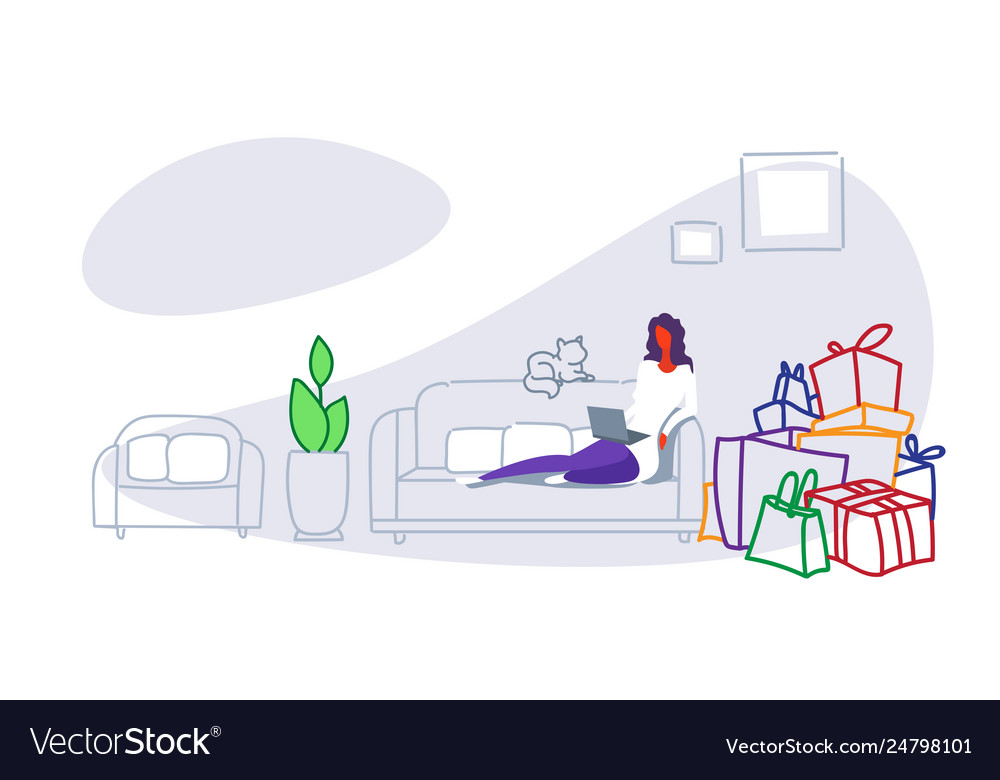 Casual woman sitting on couch using computer