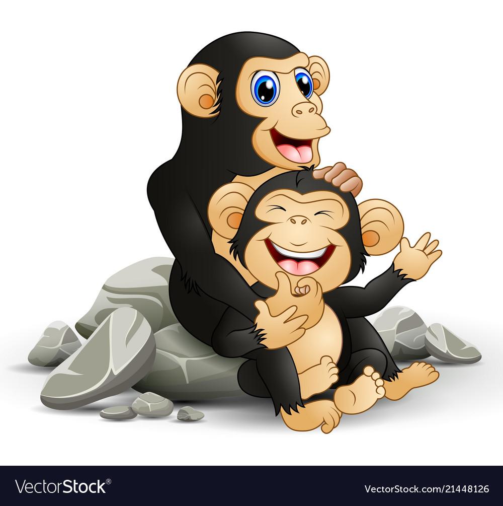 Happy chimpanzee mother hug her baby chimp